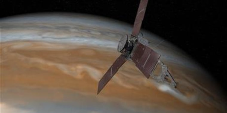 This artist's rendering shows the Juno spacecraft above Jupiter.
