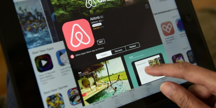 A woman browses the site of US home sharing giant Airbnb.