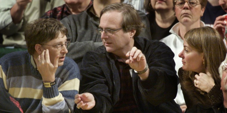 PAUL ALLEN AND BILL AND MELINDA GATES WATCH TRAILBLAZERS PLAYSUPERSONICS IN SEATTLE.