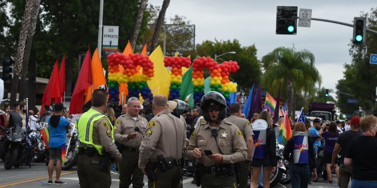 Police stand by to provide security for the 2016 Gay Pride Parade June 12, 2016 in Los Angeles, California. Security tightened in the aftermath of the deadly shootings on June 12 at the Pulse Nightclub in Orlando, Florida.