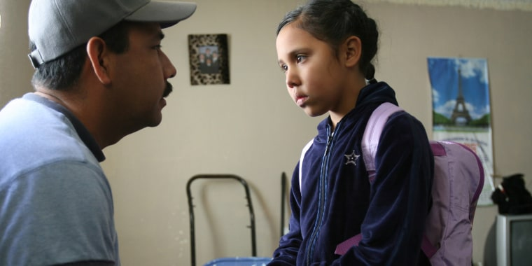Abel Munoz offers his daughter Adilene, 8, some words of encouragement as she readies to head back