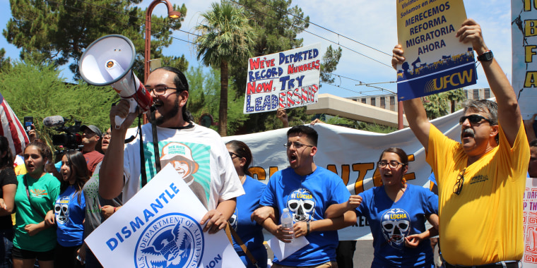 Dozens protested Thursday outside the U.S. Immigration and Customs Enforcement office in Phoenix hours after the U.S. Supreme Court issued a 4-4 ruling over President Obama's immigration plan.
