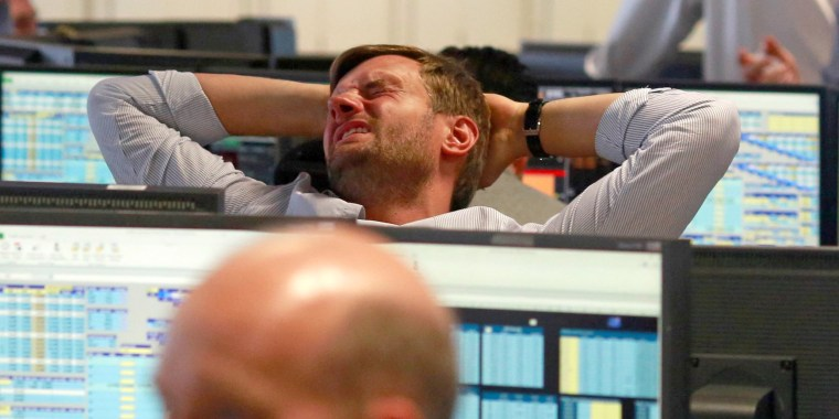 Image: A trader from BGC, a global brokerage company in London's Canary Wharf financial centre reacts during trading