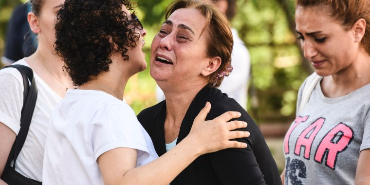 Image: A mother of victims reacts outside a forensic medicine building  in Istanbul