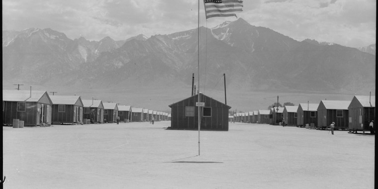 Manzanar Relocation center, Manzanar, California. Street scene of barrack homes at this War Relocation Authority Center. The windstorm has subsided and the dust has settled. July 3, 1942