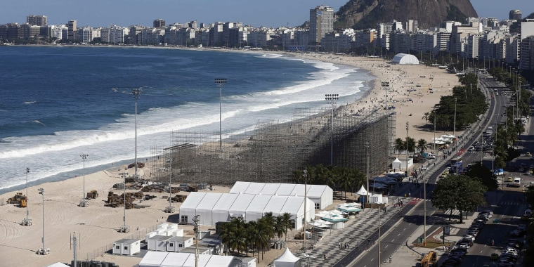 Image: Mutilated body parts wash up on a beach next to the Olympic beach volleyball site