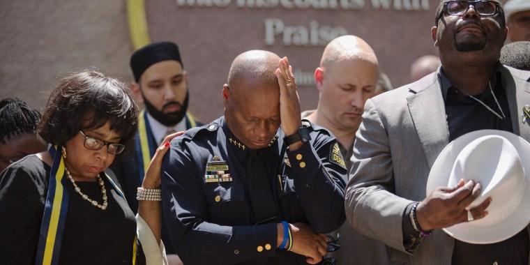 Image: Dallas Police Chief David Brown prays during a a vigil at Thanks-Giving square in Dallas