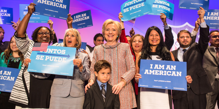 """Members of the Congressional Hispanic Caucus joined Hillary Clinton on stage after her LULAC speech and held reading """" I am an  American."""""""