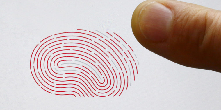 File photo shows a person using a sensor for biometric identification on a smartphone in Berlin