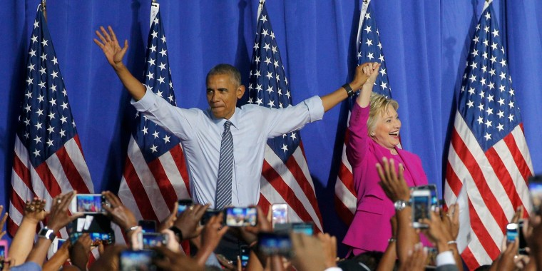 Image: U.S. President Obama waves with Democratic U.S. presidential candidate Clinton at campaign event in Charlotte, North Carolina