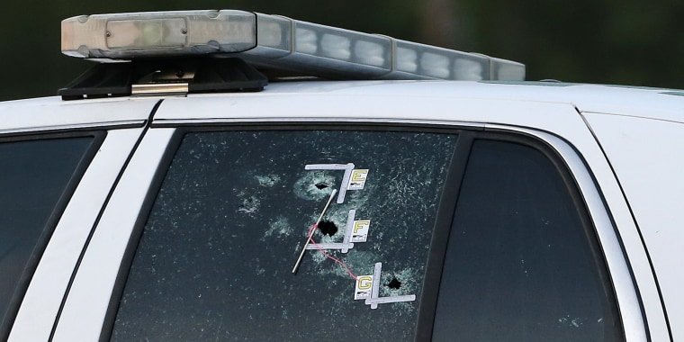Image: An East Baton Rouge Sheriff vehicle is seen with bullet holes in its windows near the scene where police officers were shot, in Baton Rouge, Louisiana