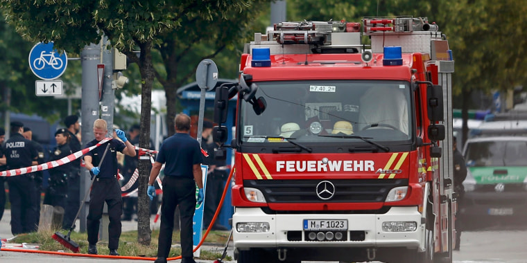Image: Members of the fire brigade attend scene near shooting rampage at Olympia shopping mall in Munich