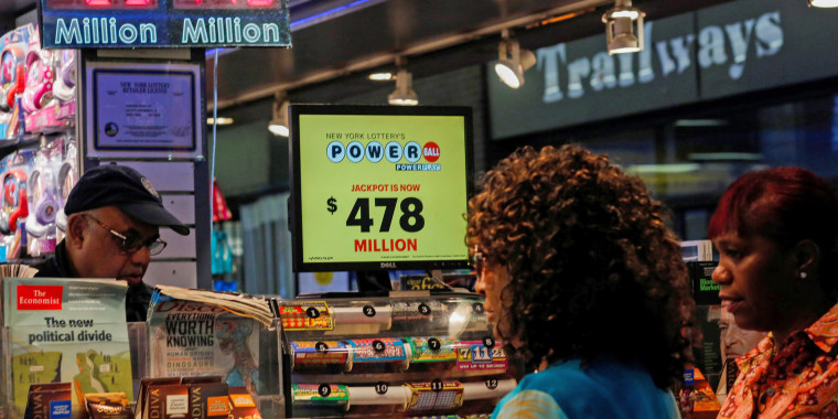 Image: Customers purchase Powerball lottery tickets in New York, U.S.