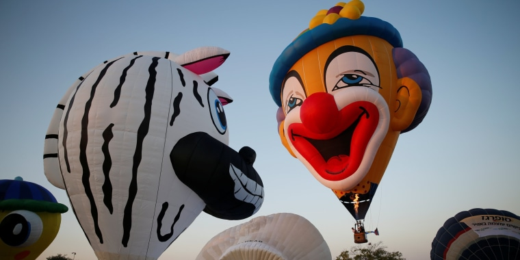 Image: Hot air balloons are prepared before they take flight during a two-day international hot air balloon festival in Eshkol Park near the southern city of Netivot