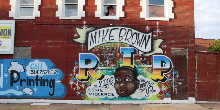 Michael Brown, 18, was gunned down by former Ferguson police officer Darren Wilson on Aug. 9, 2014. He lie in the street dead and bleeding on Canefied Drive for several hours. This mural is located in West St. Louis.