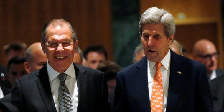 Image: U.S. Secretary of State Kerry and Russian Foreign Minister Lavrov walk into their meeting room in Geneva