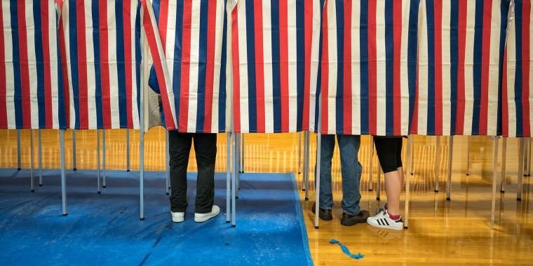Image: Voters head to the polling booths inside Bedford High school