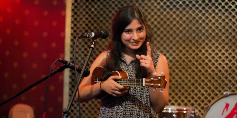 Shilpa Shah on stage at a 2014 Subcontinental Drift - NYC open mic hosted at Pete's Candy Store