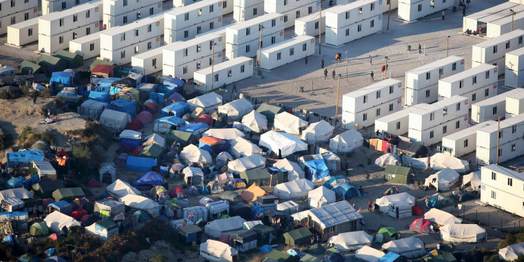 """Image: An aerial view shows """"The Jungle"""" in Calais, France"""