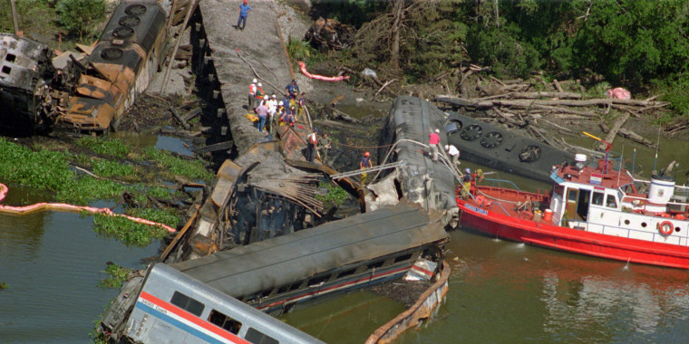 The wreckage of the Amtrak Sunset Limited train lies in the bayou north of Mobile, Alabama, on Sept. 22, 1993. A barge hit a railroad bridge and minutes later the train hit the bent tracks and plunged into the bayou, killing 47 people.