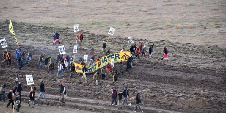 Activists march near highway 1806 in North Dakota to protest the Dakota Access Pipeline on Oct. 22.