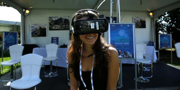 Image: Woman wears virtual reality device for SXSL festival at the White House in Washington