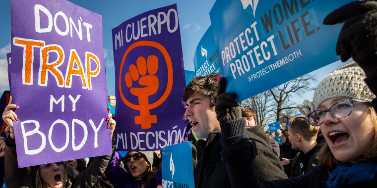 Image: Pro-choice advocates (left) and anti-abortion advocates (right) rally outside of the Supreme Court