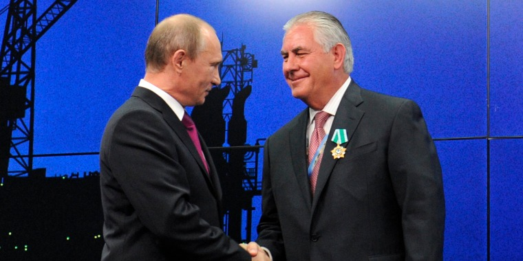 Image: Russian President Vladimir Putin presents ExxonMobil CEO Rex Tillerson with a Russian medal at an award ceremony