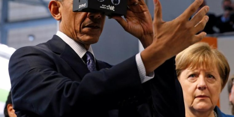 U.S. President Obama tries virtual reality glasses as he and German Chancellor Merkel tour Hanover Messe Trade Fair in Hanover