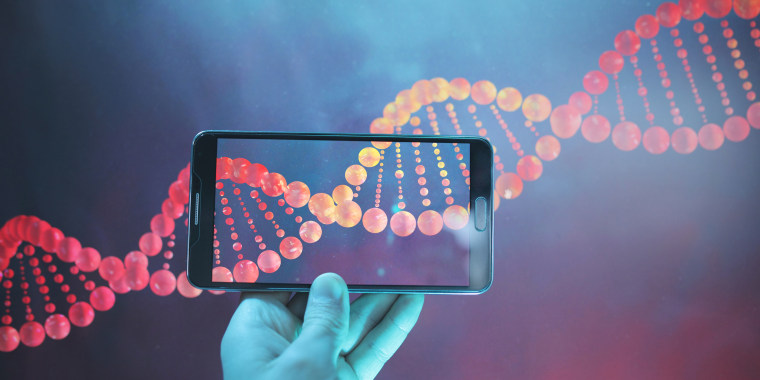 Image: DNA double helix strand viewed with a phone