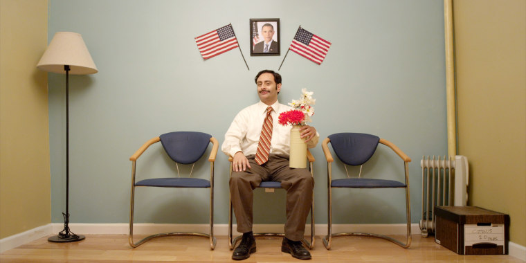 """A promotional still from """"Brown Nation"""" featuring Hasmukh portrayed by Rajeev Varma."""