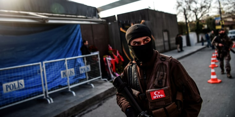 Image: A Turkish special force police officer walks in front of the Reina nightclub