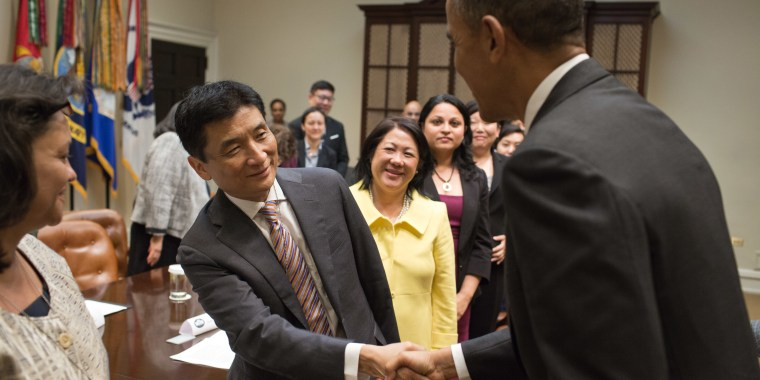 President Barack Obama shakes hands with Bill Imada in a meeting with a group of Asian American and Pacific Islander (AAPI) national leaders to discuss immigration reform, in the Roosevelt Room of the White House, May 8, 2013.