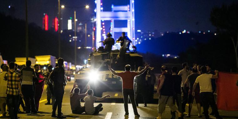 Image: People take over a tank near the Fatih Sultan Mehmet bridge