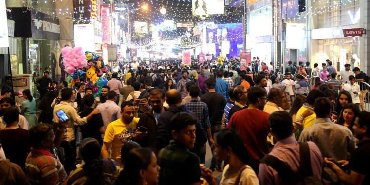 Image: Hundreds of people gather to attend the eve of new year celebration in Bangalore