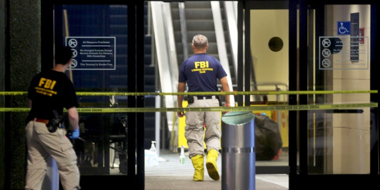 Image: Investigators continue their work in Terminal 2 at Fort Lauderdale International Airport on Jan. 7, the day after a shooting in the baggage area.