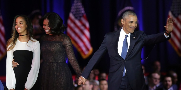 Image: First Lady Michelle Obama and President Barack Obama greet supporters as daughter Malia looks on after the President delivered his farewell address in Chicago, Illinois on Jan. 10.