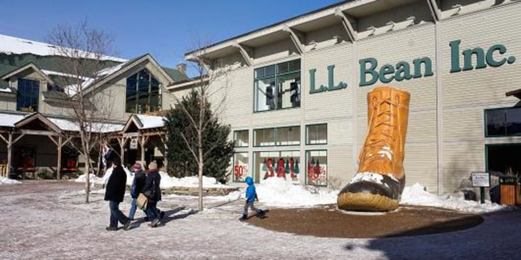 People walk through a plaza at an entrance to the L.L. Bean flagship store in Freeport, Maine. Gregory Rec | Portland Press Herald | Getty Images