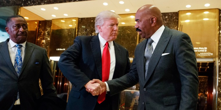 Image: President-elect Donald Trump shakes hands with comedian Steve Harvey in the lobby of Trump Tower in New York on Jan. 13.