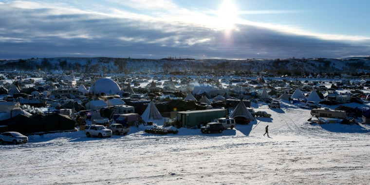 Image: Vehicles and campsites can be seen inside Oceti Sakowin camp