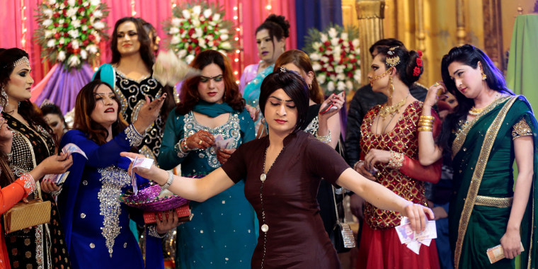 Image: Members of the transgender community dance at Shakeela's party in Peshawar