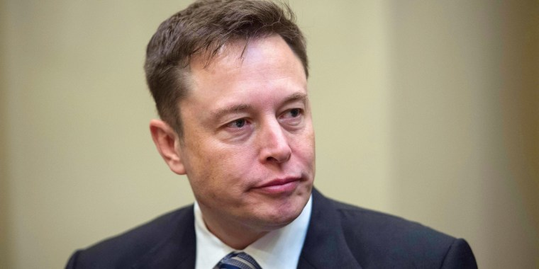 Image: Elon Musk listens to President Donald Trump during a meeting with business leaders