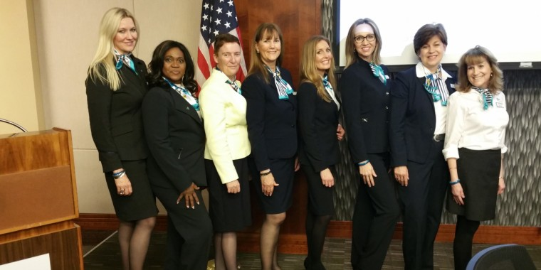 Image: Airline Ambassadors International President Nancy Rivard (fourth from the right) stands with a group of Airline Ambassador trainers in Houston, Texas.