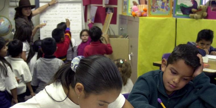 ELEMENTARY SCHOOL STUDENTS WRITE IN CLASSROOM