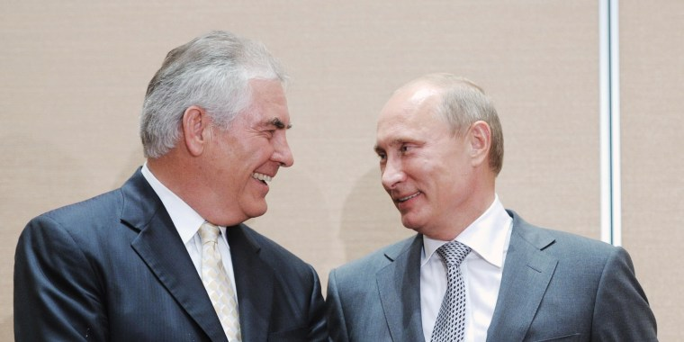 Image: Rex Tillerson and Vladimir Putin attend a meeting in August 2011