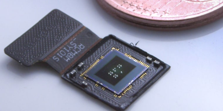 Image sensor and lenses, next to a coin for comparison.