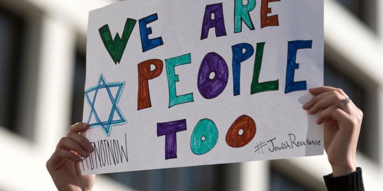 Image: Protester holds a sign during a demonstration in Beverly Hills, California, Dec. 4, 2016.
