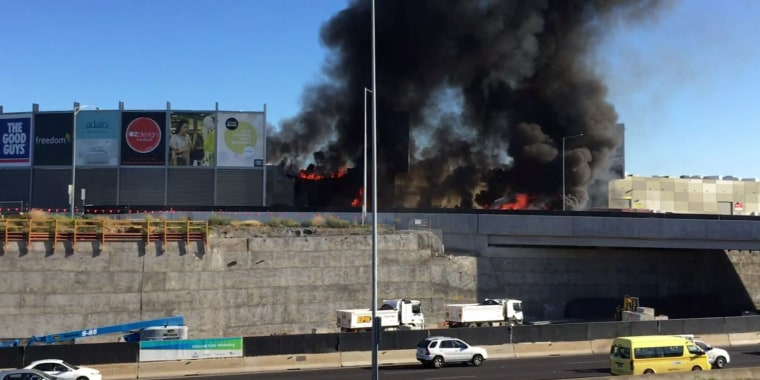 Image: Twin-engined Beechcraft plane crashed into a shopping centre just after take-off from Essendon Fields airport near Melbourne