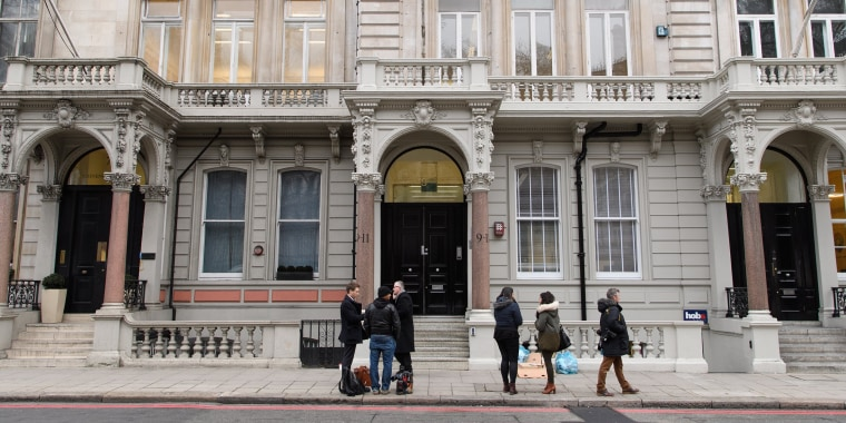 Image: Journalists gather outside the headquarters of Orbis Business Intelligence, the company run by former intelligence officer Christopher Steele, on Jan. 12 in London.