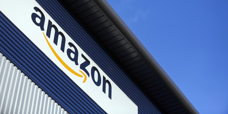Image: A sign hangs above at the Amazon.com Inc. fulfillment center